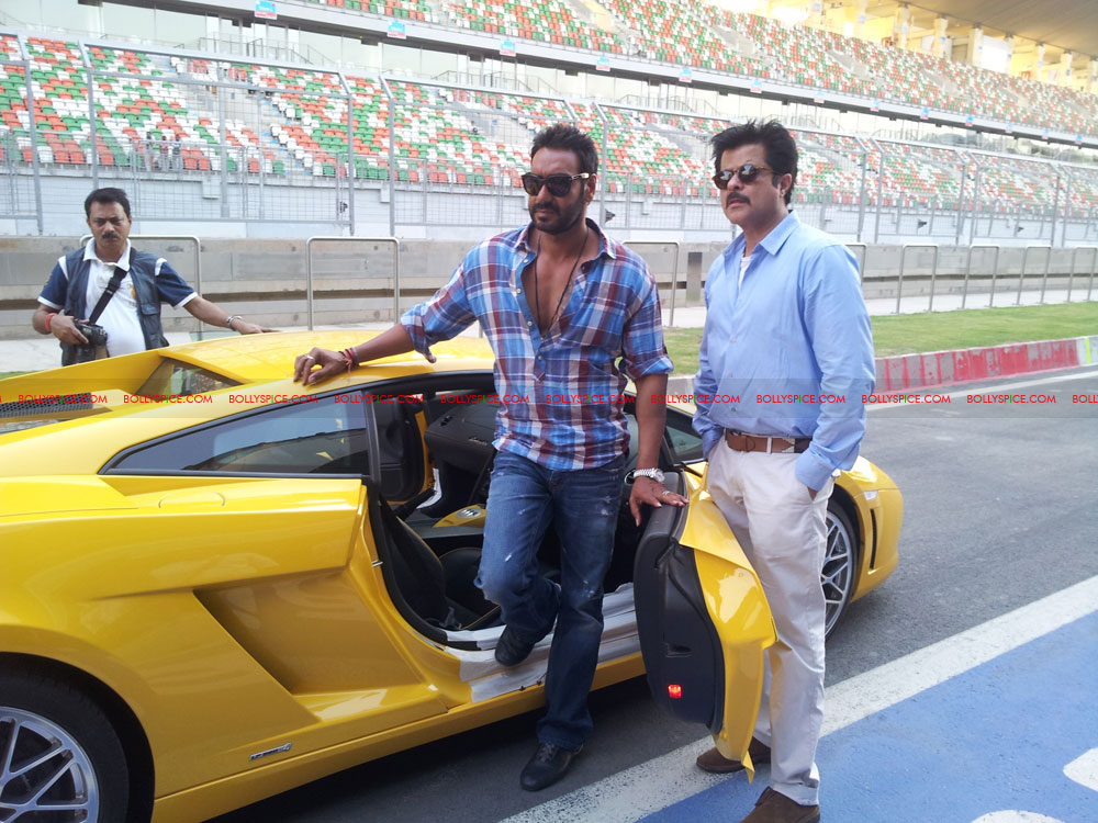12apr ajay anil f1race01 Ajay Devgn Beats Anil Kapoor to the Checkered Flag