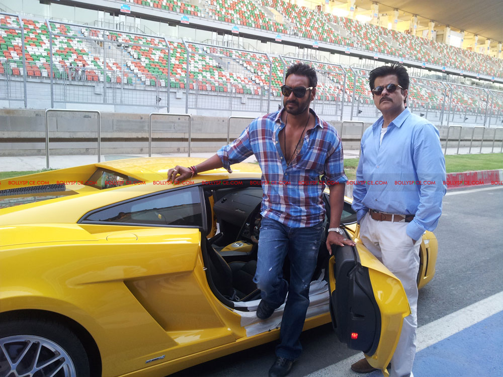 12apr ajay anil f1race02 Ajay Devgn Beats Anil Kapoor to the Checkered Flag