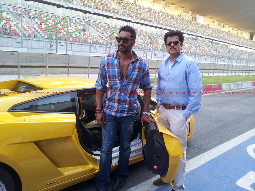 12apr ajay anil f1race03 Ajay Devgn Beats Anil Kapoor to the Checkered Flag