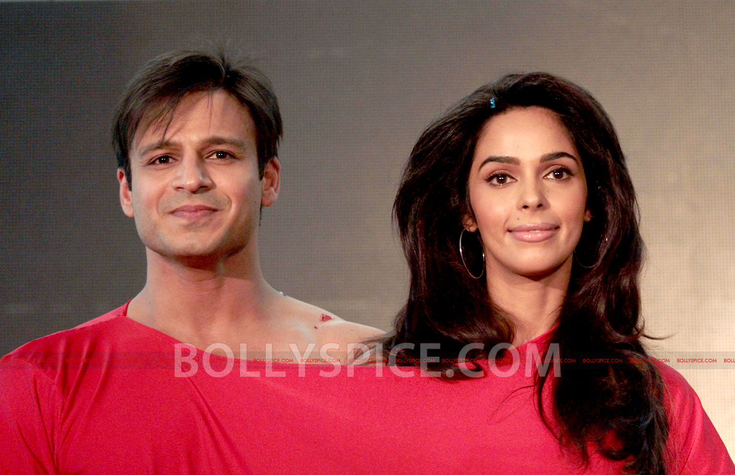 12jul KLPD1stlooklaunch07 Vivek Oberoi and Mallika Sherawat unveil the first poster of Kismat Love Paisa Dilli