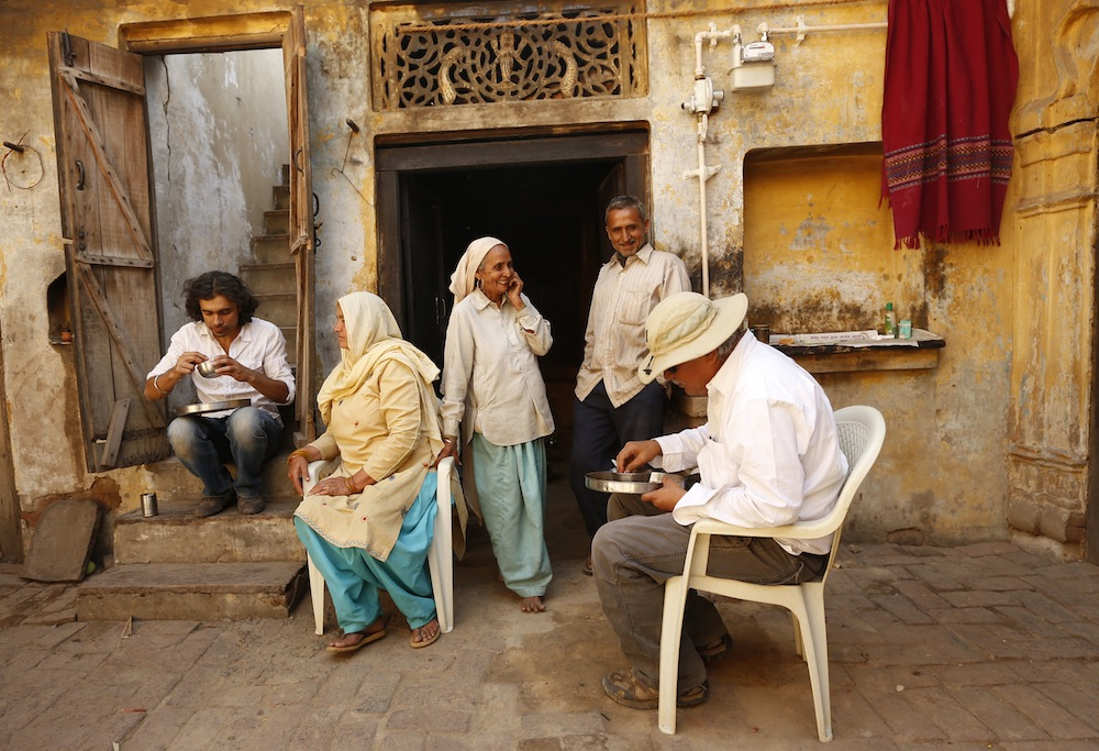 Imtiaz Ali and Anil Mehta (DoP) enjoy a simple meal cooked by the residents of the house they were shooting in for HIGHWAY, Village Dayalpur-Haryana