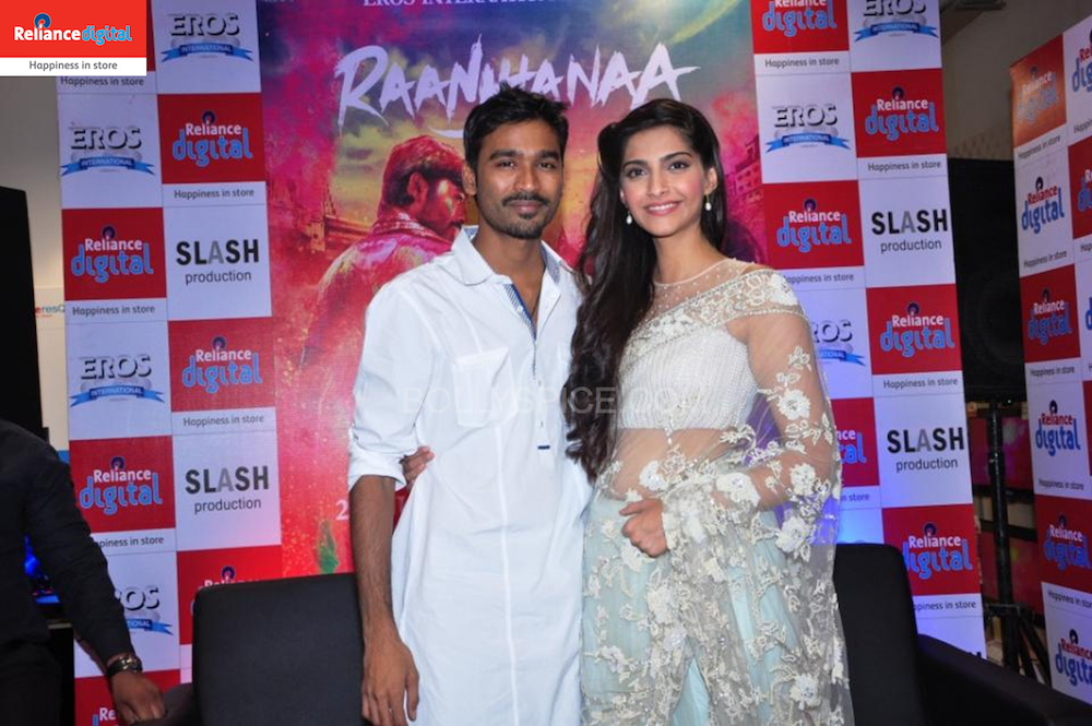 Sonam and Dhanush pose for the Shutterbugs at Reliance Digital Faridabad Sonam and Dhanush visit Reliance Digital Store to Promote Raanjhanaa!