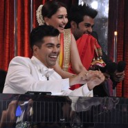 Judges Karan Johar and Madhuri Dixit with show host Manish Paul