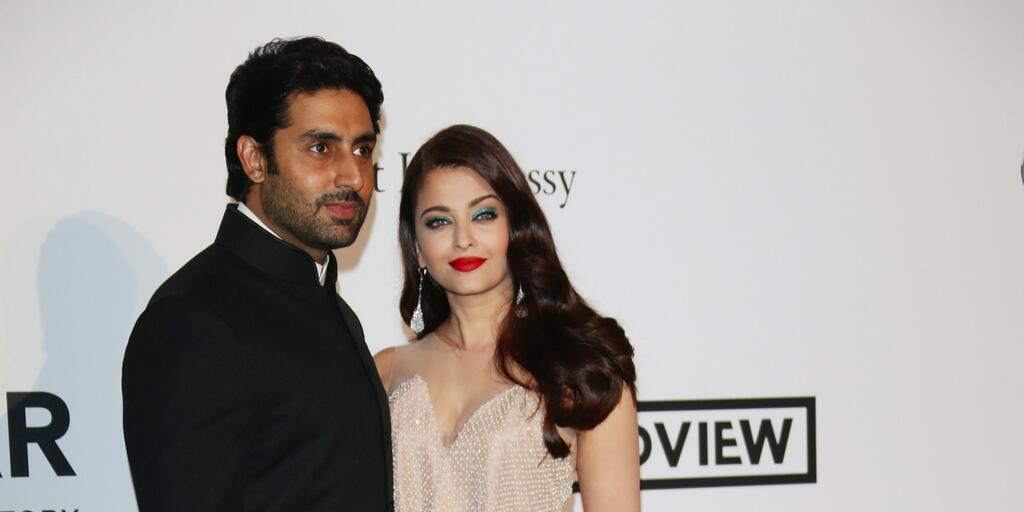 14may CannesAbhiAish amFAR12 Abhishek and Aishwarya at amfARs 21st Cinema Against AIDS Gala in Cannes 2014