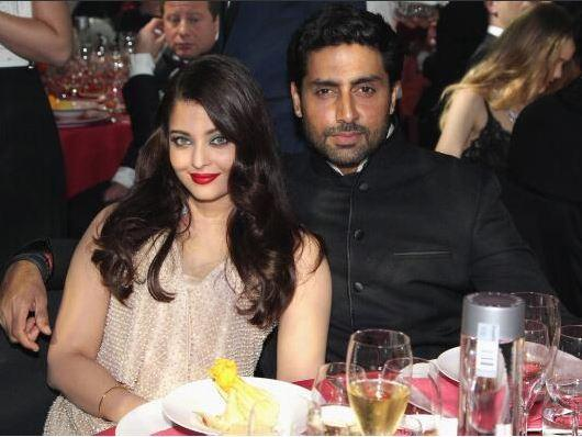 14may CannesAbhiAish amFAR18 Abhishek and Aishwarya at amfARs 21st Cinema Against AIDS Gala in Cannes 2014