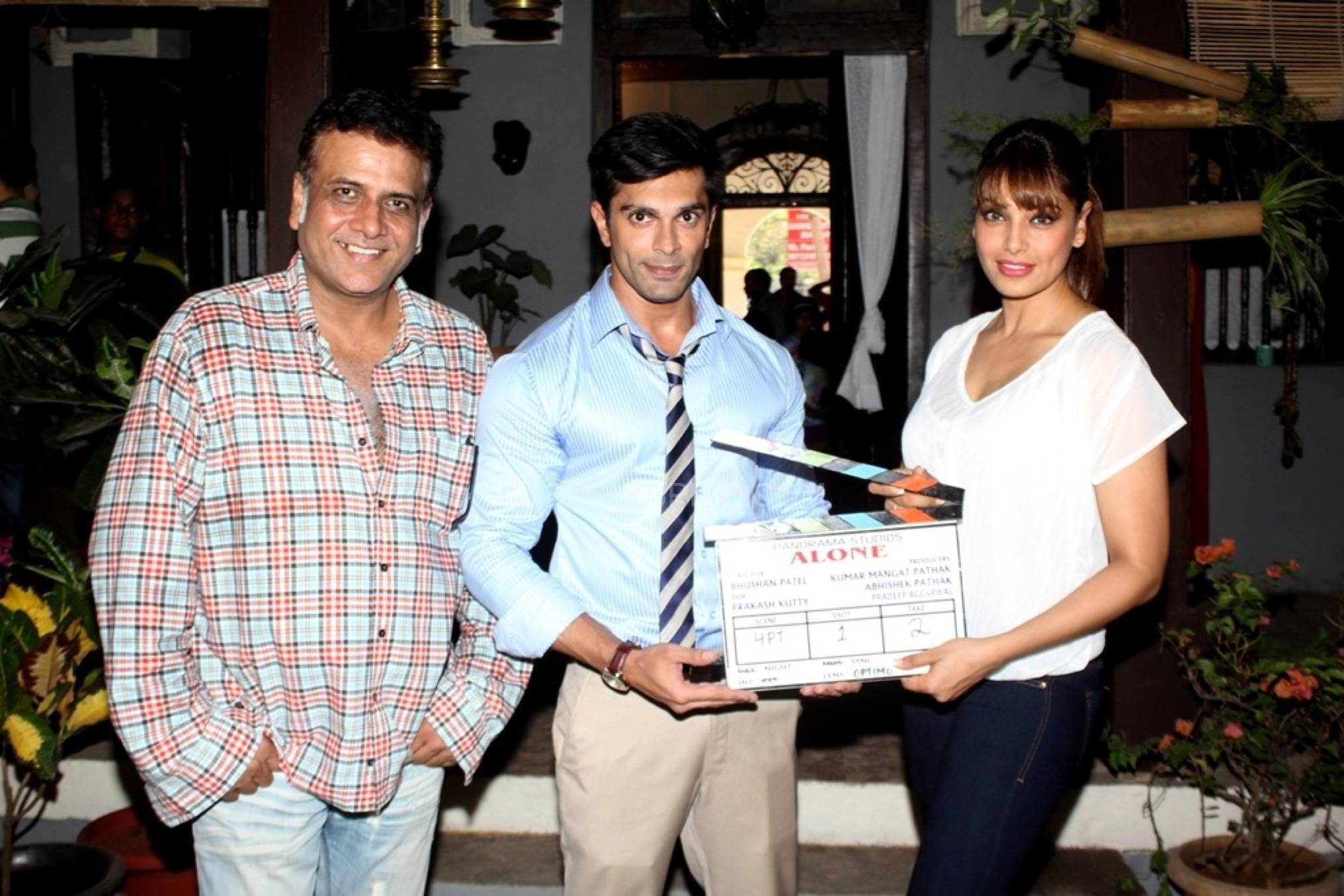 Director Bhushan Patel Karan Singh Grover and Bipasha Basu Bipasha Basu Gives Mahurat Clap for her love story with chills tentatively titled Alone!