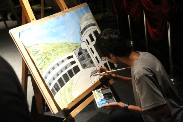 Student painting at a masterclass_Whistling Woods International