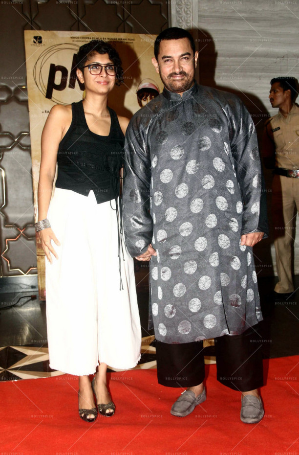 Bollywood actor Aamir Khan along with his wife and filmmaker Kiran Rao during the success party of film P K in Mumbai, India on June 10, 2015