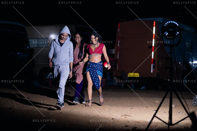 Sunny side up: Sunny Leone being escorted to a shoot at midnight (Ek Paheli Leela)