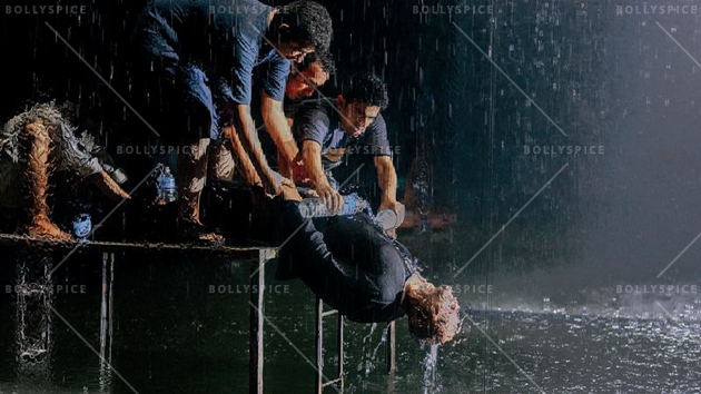 A good drenching: Helpers use bottles of water to create a waterfall effect on the actor (Paap)
